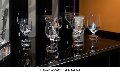 Coffee capsules in transparent glasses on a black background. Coffee shop showcase selling granular encapsulated coffee for coffee machines