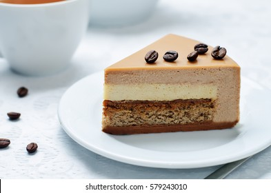 Coffee caramel cream brulee mousse cake. toning. selective focus