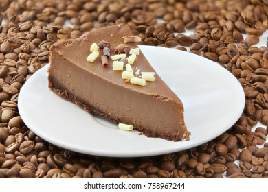 coffee cheesecake on a white plate on a wooden table