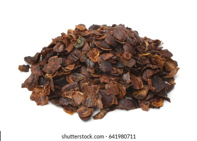 Coffee cherry tea made from the dried skins of dried berries of the coffee plant (cascara) on white background