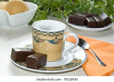 Coffee with chocolate, biscuits