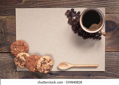 Coffee with chocolate cookies and paper for text on dark wooden background, top view
