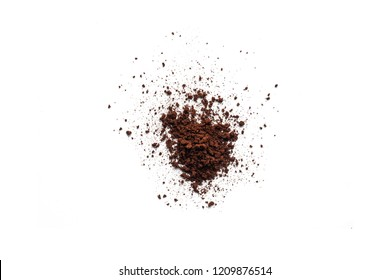 Coffee or chocolate powder ingredient burst isolated on white background