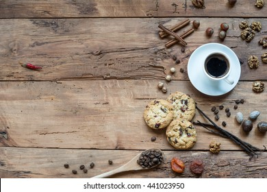 Coffee, chocolate, vanilla pods, cinnamon sticks, anise stars on wooden rustic table
