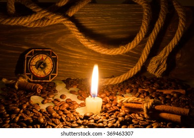 Coffee and cinnamon rolls by candlelight