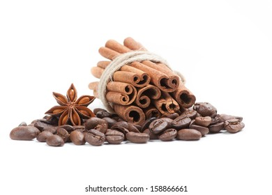 Coffee, cinnamon and star anise on white