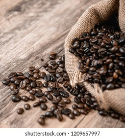 Coffee in clear glass on wood background. Coffee beans sack