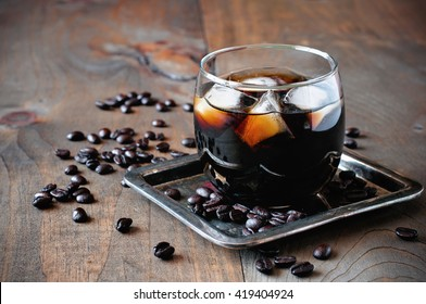 Coffee cocktail,  Black Russian,  liquor in glasses with coffee beans on a wooden background, selective focus, toned image