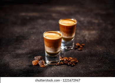 Coffee cocktail with liquor in shot glasses on a dark vintage background