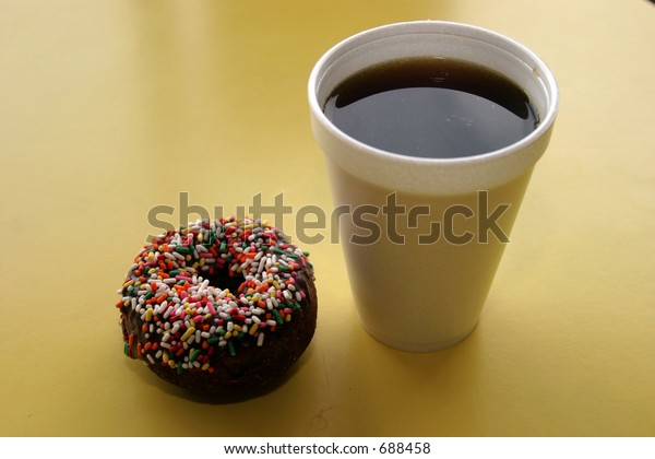 coffee and colored sprinkled donut