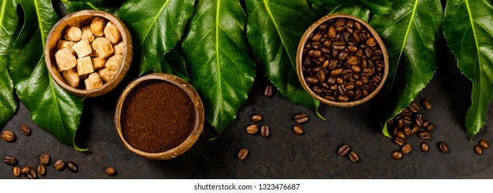 Coffee composition on dark rustic background, flat lay, top view