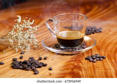 Coffee concept for design and advertising, a cup of coffee, coffee beans, coffee cup on table