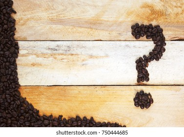 Coffee concept design - question for designing concepts - caffeine, health issues, choice of coffees. With coffee beans on a natural, rustic, background texture.