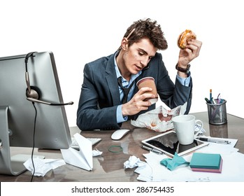 Coffee and conversation: While talking intensely on a phone, manager sitting with a cup / modern office man at working place, sloth and laziness concept
