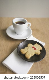 Coffee and cookie on a table