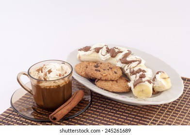 coffee, cookies, banana cream and chocolate on a white background
