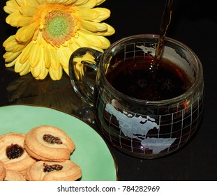 Coffee and cookies with decorative flower accent