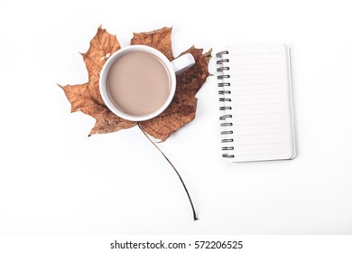 coffee with cream and maple leaf on a white background