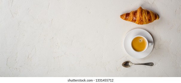 Coffee and croissant, flat lay, top view