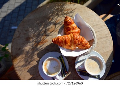 Coffee and croissants in Parisian bistro