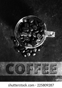 Coffee crop beans in little glass cup,monotone color background