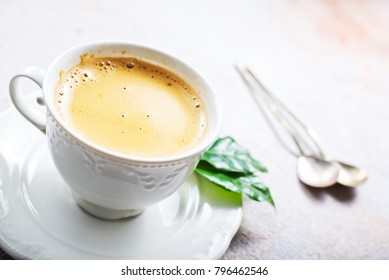 coffee in cup amd on a table