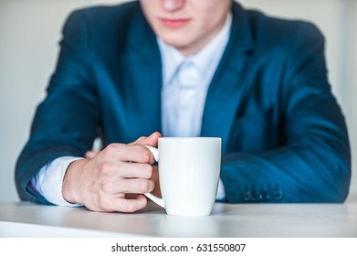 Coffee cup of anxious man