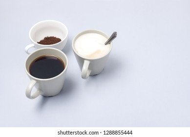 Coffee Cup Assortment Cup of Espresso Cup of Cappuchino Cup with Ground Coffee Blue Background Copy Space