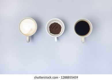 Coffee Cup Assortment Cup of Espresso Cup of Cappuchino Cup with Ground Coffee Top View Blue Background