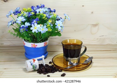 coffee cup and coffee bean with flower vase