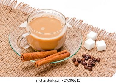Coffee cup bean sugar cube Cinnamon on jute sack background
