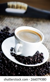 Coffee cup with coffee beans.