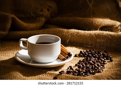 Coffee cup and coffee beans around