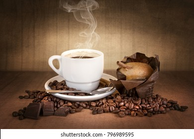coffee cup with coffee beans, chocolate and muffin