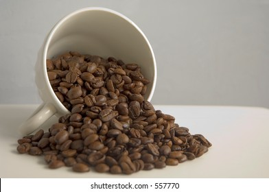 Coffee cup with coffee beans galore