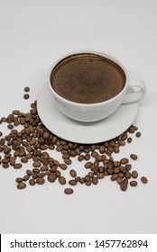 Coffee in cup and coffee beans, isolates spread on a white background