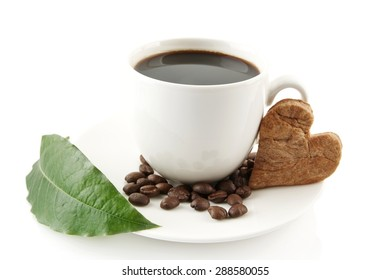 Coffee cup with beans with leaf and saucer on white