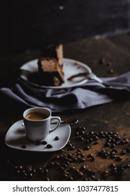 Coffee cup and beans on a black background. coffee with cake. top view
