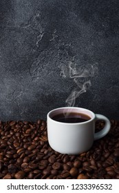 Coffee Cup and coffee beans on Dark background Copy space