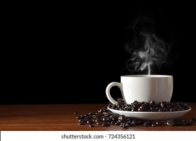 coffee cup and beans On dark wooden  background