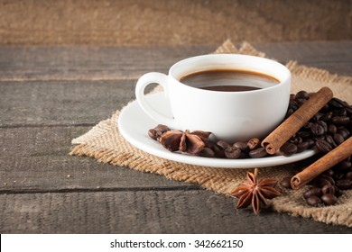 Coffee cup and beans on a rustic background. Coffee Espresso. Cup Of Coffee and coffee beans on table.