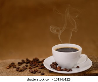 Coffee cup and coffee beans on table.
