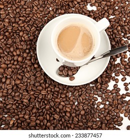 Coffee cup and beans on a white background. studio