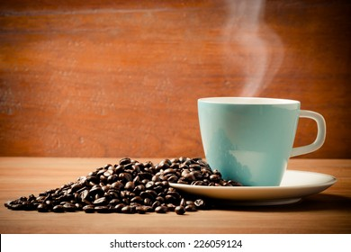 Coffee cup and coffee beans, vintage style