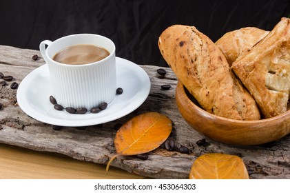 Coffee cup and bread on a wooden table. Breakfast