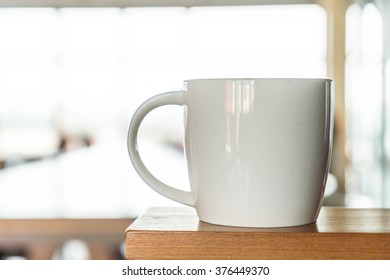 coffee cup in cafe - soft focus with vintage effect picture style