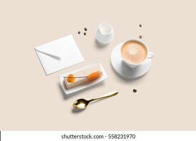 Coffee cup with cake, breakfast set, including white blank envelope template, isometric view.