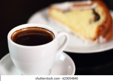 Coffee cup and cake with sugar icing