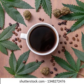 Coffee cup and cannabis with beans, nugs and marijuana leaves over wood background, marijuana edibles concept