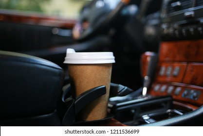 Coffee cup in car holder